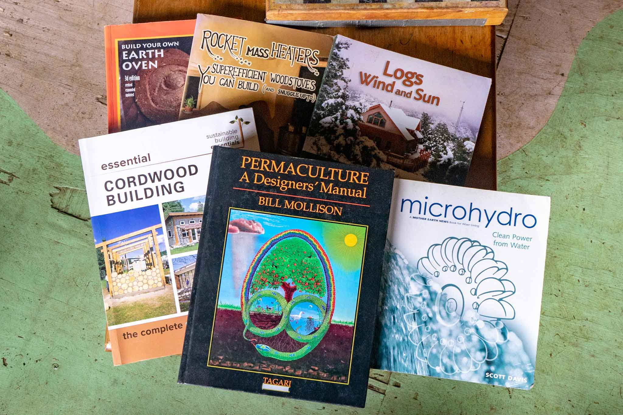 books on permaculture, hydro-power, cordwood building, and heated furniture